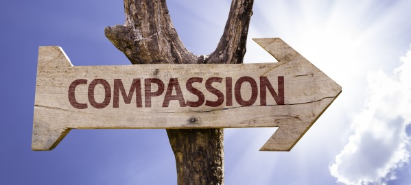"photo of a sign that says ""Compassion"""