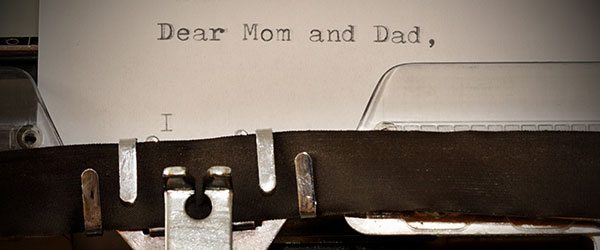 """photo of a typewriter with message """"Dear Mom and Dad,"""""""