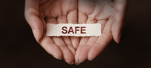 hands holding note that says safe