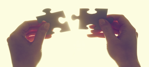 hands-holding-puzzle-pieces