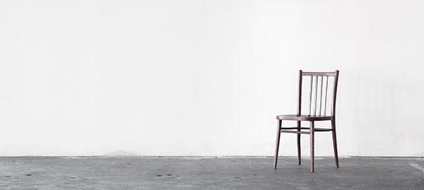 empty room with an empty chair