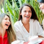 4 women laughing