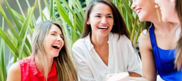 4 women laughing