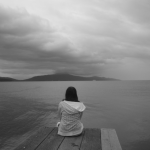 depressed person gazing into the lake