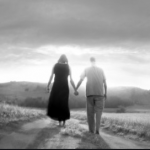 man and woman walking and holding hand